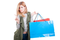 Pretty modern girl doing refusal gesture. After doing shopping isolated on white background with copyspace Stock Photography