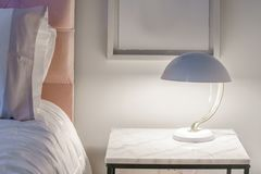Free Pretty Modern Night Light On A Small Table Stock Images - 124189064