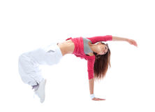 Modern slim hip-hop style teenage girl jumping dancing Royalty Free Stock Image