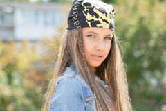 Confident young teenage woman in bandana royalty free stock photography