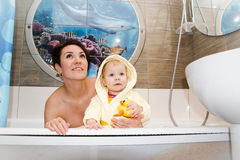 Pretty mom and cute baby in a bathroom Stock Photography
