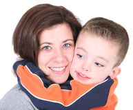 Pretty mom embracing cute son. On white Royalty Free Stock Photos