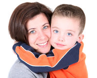 Pretty mom embracing cute son. On white Stock Images