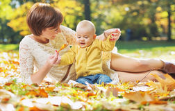 Pretty mom playing with child Royalty Free Stock Photos