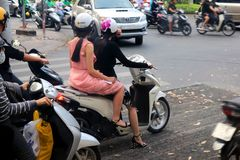 Pretty moped women in ho chi minh - vietnam asia stock photos