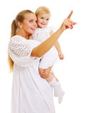 Pretty mother and baby looking ahead Stock Photo