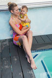 Pretty mother and baby at the swimming pool. At the leisure center stock photography