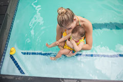 Pretty mother and baby at the swimming pool. At the leisure center stock images