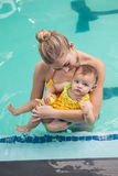 Pretty mother and baby at the swimming pool. At the leisure center royalty free stock images