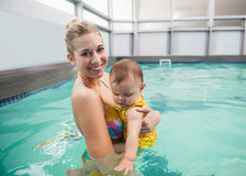 Pretty mother and baby at the swimming pool. At the leisure center royalty free stock photography