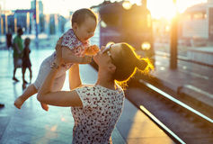 Pretty mother carrying her little daughter Royalty Free Stock Photography