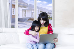 Pretty mother and child use laptop Stock Image