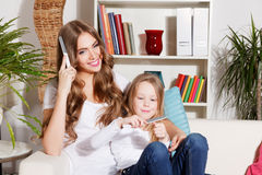 Pretty mother and daughter doing manicure Stock Images