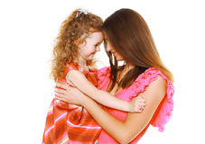 Pretty mother and daughter in dress having fun Royalty Free Stock Photos