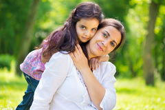 Pretty mother with daughter at summer park Stock Photo