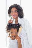Pretty mother getting ready with her daughter Stock Images