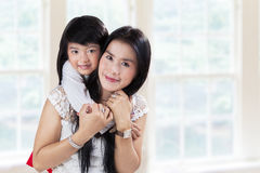 Pretty mother and her daughter at home Royalty Free Stock Image