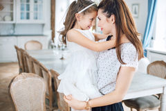 Pretty mother holding her lovely daughter Royalty Free Stock Image
