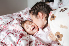 Pretty mother kissing her daughter Royalty Free Stock Photography