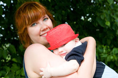 Pretty mother with little son Stock Images