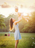 Pretty mother playing with her daughter Royalty Free Stock Photo