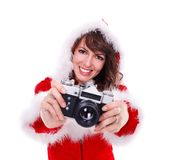 Pretty Mrs. Santa with retro camera Royalty Free Stock Image