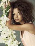 Pretty mulatto with a curly haircut Stock Photos