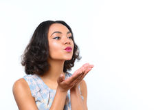 Pretty mulatto girl blowing kiss Royalty Free Stock Photography