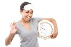 Pretty mulatto girl posing with clock Stock Image