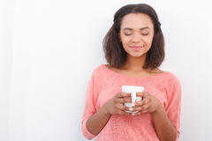 Pretty mulatto girl posing with cup Royalty Free Stock Photo
