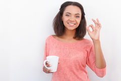 Pretty mulatto girl posing with cup stock photography