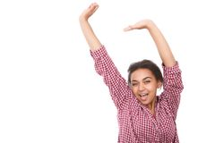 Pretty mulatto girl standing with arms up Stock Image