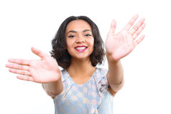 Pretty mulatto girl with welcoming embrace Royalty Free Stock Images