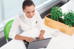 Pretty mulatto girl working on computer Royalty Free Stock Image