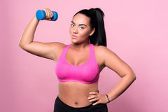 Pretty mulatto woman doing exercises with dumbbell Royalty Free Stock Image