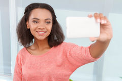 Pretty mulatto woman doing selfie Royalty Free Stock Image