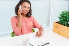 Pretty mulatto woman talking per mobile phone Stock Photo