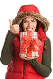 Pretty mum holding gift giving thumbs up Stock Photos