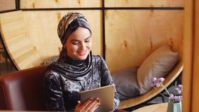 Pretty muslim girl in hijab in cafe. Pretty muslim girl in hijab in cafe stock video