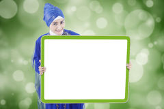 Pretty muslim woman holds empty board stock photography