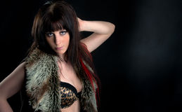 Pretty and mysterious brunette in leopard skin bra Royalty Free Stock Images