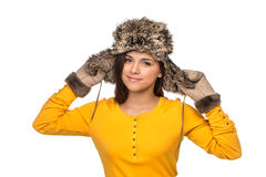 Pretty and nice girl in yellow sweater and fur hat. Royalty Free Stock Photography