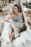 Pretty nice woman enjoying her new hammock