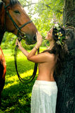 Pretty nude woman with horse Stock Photos