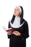 Pretty nun with Bible isolated on the white Royalty Free Stock Photography