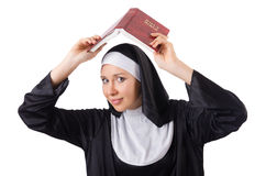 Pretty nun with Bible isolated on the white Stock Photo