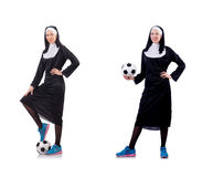 The pretty nun with football ball isolated on white. Pretty nun with football ball isolated on white Royalty Free Stock Image