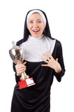 Pretty nun holding winner cup isolated on the Stock Image