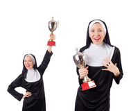 The pretty nun holding winner cup isolated on white Stock Images