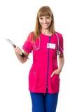 Pretty nurse with folder Stock Photo